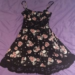A dress with skulls and pink flowers